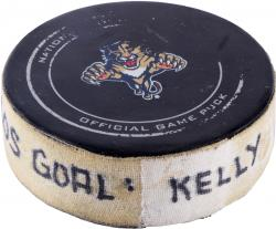Chris Kelly Boston Bruins 2/24/13 Game-Used Goal Puck at Florida Panthers - Mounted Memories