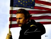 """Kevin Costner Autographed 11"""" x 14"""" Dances With Wolves - Holding American Flag Photograph - Beckett COA"""