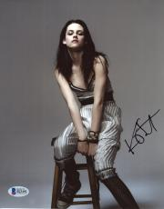 "Kristen Stewart Autographed 8"" x 10"" Posing On Chair Photograph - Beckett COA"