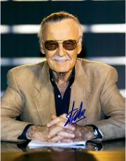 Stan Lee Autographed 11'' x 14'' In Suit Sitting Photograph