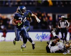 Marshawn Lynch Seattle Seahawks Autographed 16'' x 20'' vs. Tracy Porter Photograph - Mounted Memories