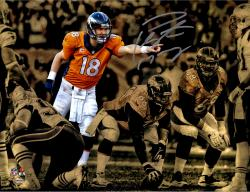Peyton Manning  Denver Broncos Autographed 11'' x 14'' Spotlight Over Line Photograph - Mounted Memories