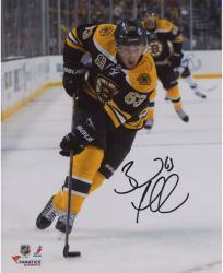 "Brad Marchand Boston Bruins Autographed 8"" x 10"" Vertical Black Uniform Skating Photograph"