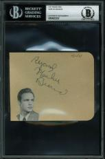 "Marlon Brando ""Regards"" Signed 4x4.5 Album Page BAS Slabbed"