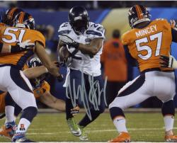 Marshawn Lynch Seattle Seahawks Super Bowl XLVIII Champions Autographed 8'' x 10'' Running Photo - Mounted Memories