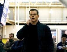 "Matt Damon Autographed 11"" x 14"" Jason Bourne - Talking into Phone Photograph - Beckett COA"