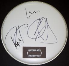 Metallica Autographed Drum Head with Metallica logo sticker by Lars Ulrich, Kirk Hammett, and Robert Trujillo