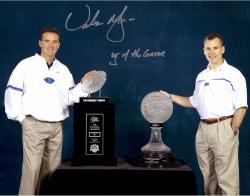 Urban Meyer Florida Gators Autographed 11'' x 14'' Trophies Photograph with Year of the Gator Inscription - Mounted Memories