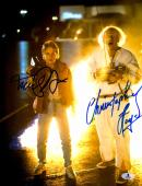 "Michael J Fox And Christopher Lloyd Autographed 11"" x 14"" Back To The Future Standing In Front Of Fire Photograph - Beckett COA"