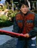 """Michael J Fox Autographed 11"""" x 14"""" Back To The Future II Holding Hover Board Photograph - Beckett COA"""
