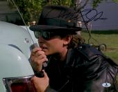"""Michael J Fox Autographed 11"""" x 14"""" Back To The Future Talking Into Walkie Talkie With Black Hat Photograph - Beckett COA"""