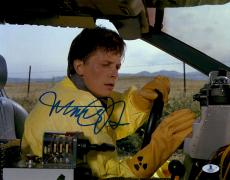 """Michael J Fox Autographed 11"""" x 14"""" Back To The Future Wearing Yellow Suit in Delorean Photograph - Beckett COA"""