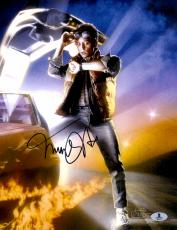 "Michael J Fox Autographed 11""x 14"" Back to the Future Looking at Watch Photograph - BAS COA"