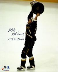 "Mike Modano Dallas Stars Autographed 16"" x 20"" Raising Cup Photograph With 1999 SC Champs Inscription"