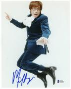 "Mike Myers Autographed 8""x 10"" Austin Powers Jumping In Air Photograph - Beckett COA"
