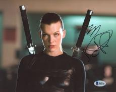 "Milla Jovovich Autographed 8"" x 10"" Resident Evil with Swords on Back Photograph - Beckett COA"