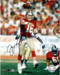 Joe Montana San Francisco 49ers Autographed 8'' x 10'' Leg Up Red Uniform Photograph - Mounted Memories