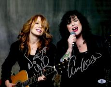 "Nancy Wilson And Ann Wilson Autographed 11"" x 14"" Heart Dark Background Photograph - Beckett COA"