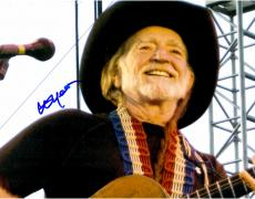 Willie Nelson Autographed 11'' x 14'' Smiling By Microphone Photograph