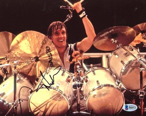 """Nicko McBrain Autographed 8"""" x 10"""" Iron Maiden Playing The Drums Photograph - Beckett COA"""