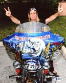 "Nicko McBrain Autographed 8"" x 10"" Iron Maiden Sitting on Blue Motorcycle Photograph - Beckett COA"