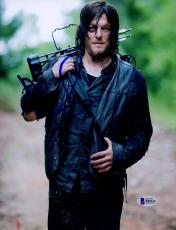 "Norman Reedus Autographed 8"" x 10"" Holding Crossbow on Shoulder Photograph - Beckett COA"