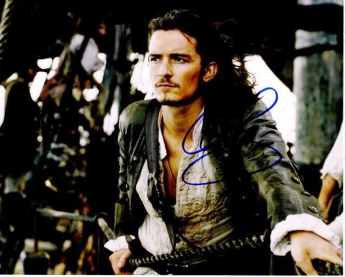 Orlando Bloom Signed - Autographed Pirates of the Caribbean 8x10 inch Photo - Guaranteed to pass PSA or JSA as Will Turner