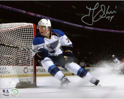 "T.J. Oshie St. Louis Blues Autographed 8"" x 10"" Skating By Net Photograph"