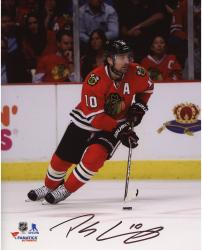 "Patrick Sharp Chicago Blackhawks Autographed Skating With Puck 8"" x 10"" Photograph"