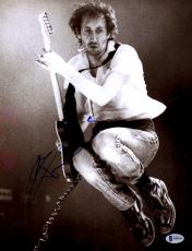 "Pete Townshend Autographed 11"" x 14"" Playing Guitar While Jumping Photograph - Beckett COA"