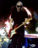 "Pete Townshend Autographed 8"" x 10"" The Who Playing Guitar Wearing Sunglasses Photograph - Beckett COA"