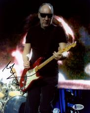 """Pete Townshend Autographed 8"""" x 10"""" The Who Playing Guitar Wearing Sunglasses Photograph - Beckett COA"""