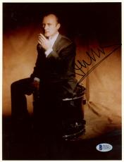 "Phil Collins Autographed 8""x 10"" Genesis Smoking Sitting On Drum Photograph - Beckett COA"