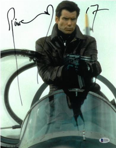 Pierce Brosnan signed James Bond 007 11X14 Photo (Full Sig-On Plane w/ Gun)- Beckett Holo #C65489