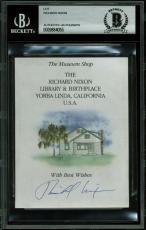 Richard Nixon Signed 3.5x4.75 Presidential Library Flyer Cut Signature BAS Slab