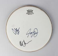 Rock Band – Rush Signed Remo Drumhead by Neil Pert, Alex Lifeson & Getty Lee- JSA Full LOA