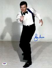 "Roger Moore Autographed 11"" x 14"" James Bond Pointing Gun Pose Photograph - PSA/DNA COA"