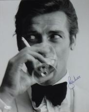 ROGER MOORE AUTOGRAPHED/SIGNED JAMES BOND 16X20 PHOTO 16944 (DRINKING) w/JSA