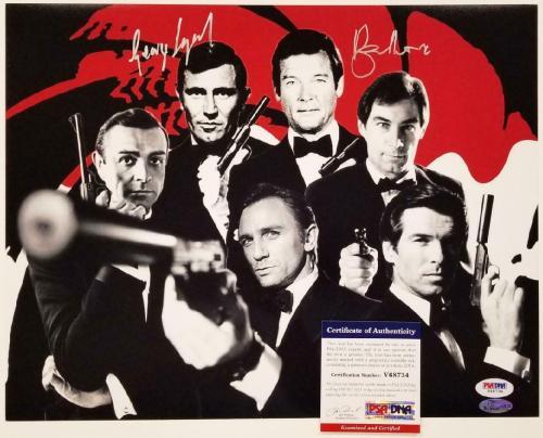 Roger Moore & George Lazenby signed 007 James Bond 11x14 Photo Autograph PSA COA