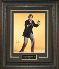 Roger Moore signed James Bond 11x14 Photo Leather Framed (yellow background)- PSA Hologram (entertainment/movie)