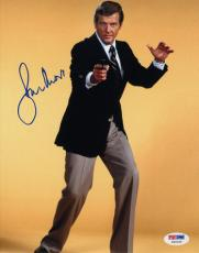 Roger Moore signed James Bond 8x10 Photo (yellow background)- PSA Hologram (entertainment/movie)