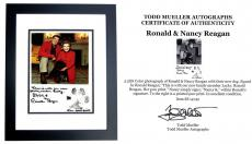 Ronald Reagan and Nancy Reagan Signed - Autographed 8x5 inch Photo with Lucky at Christmas in 1984 - BLACK CUSTOM FRAME - Deceased 2004 - Guaranteed to pass PSA or JSA