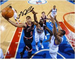 "Derrick Rose Chicago Bulls Autographed 8"" x 10"" vs. Philadelphia 76ers Photograph"