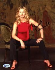 "Sarah Michelle Gellar Autographed 8"" x 10"" Posing Sitting Down Wearing Red Shirt Photograph - Beckett COA"