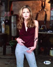 """Sarah Michelle Gellar Autographed 8"""" x 10"""" Posing Wearing Burgundy Shirt & Jeans Photograph - Beckett COA"""