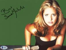 "Sarah Michelle Gellar Autographed 8""x 10"" Buffy The Vampire Slayer Holding Bat Photograph - Beckett COA"