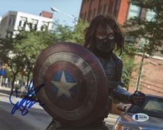 "Sebastian Stan Autographed 8"" x 10"" Holding Captain America's Shield Photograph - Beckett COA"