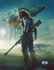 "Sebastian Stan Autographed 8"" x 10"" Holding Weapon with Background Photograph - Beckett COA"
