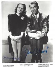 "Signed by JAMES STEWART as GEORGE BAILEY and DONNA REED as MARY HATCH in 1946 CLASSIC Movie ""IT'S A WONDERFUL LIFE"" (JAMES Passed Away 1997) and (DONNA Passed Away 1986) 8x10 B/W Photo"