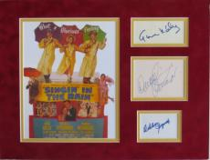 Singin' in the Rain (3) Signed Authentic Matted Display w/ Gene Kelly PSA/DNA